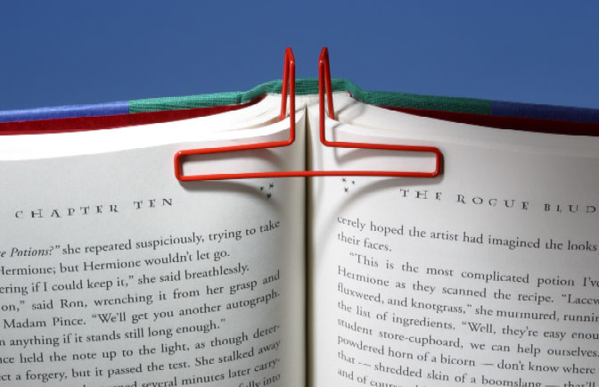 Assorted colors available for this easy to use book holder