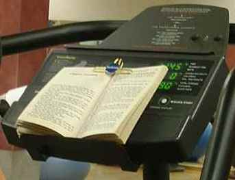 Clipped book sits on Elliptical Trainer Shelf